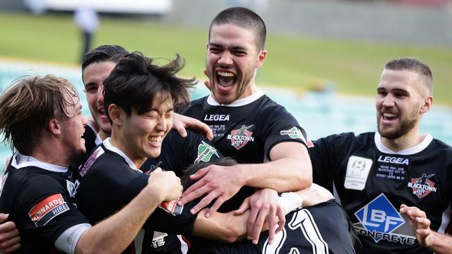 Blacktown FC players celebrate a Danny Choi goal.