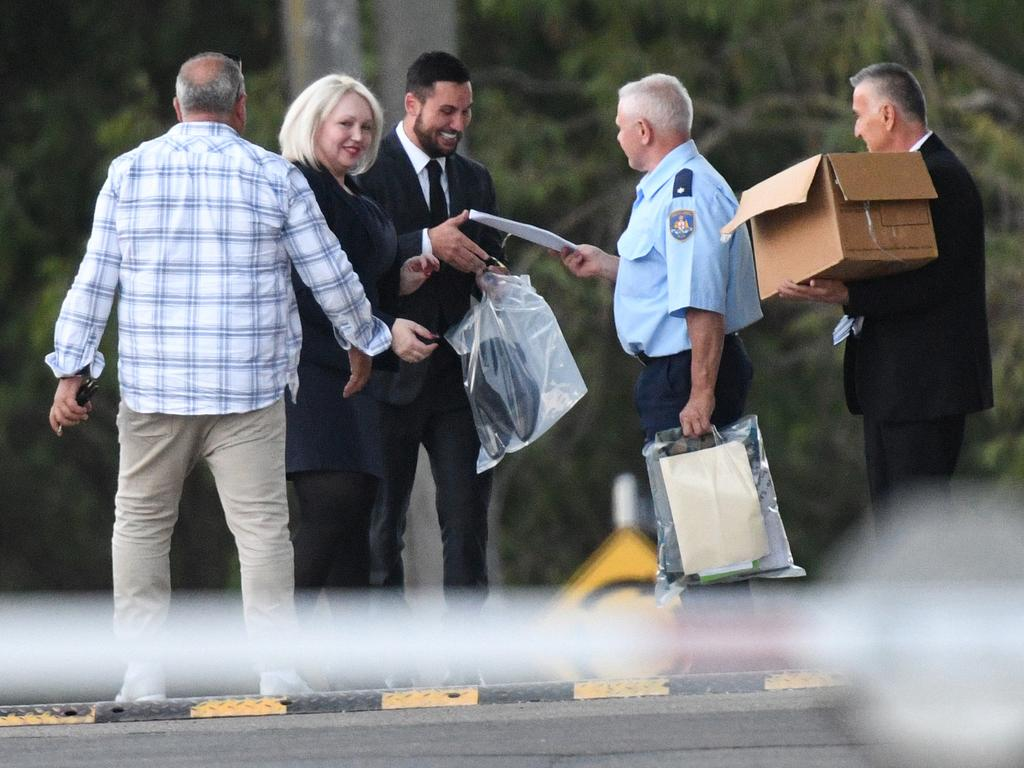 Mehajer with his father (holding box, right) emerges from Silverwater prison after he was granted bail, in April 2018. Picture: Brendan Esposito.