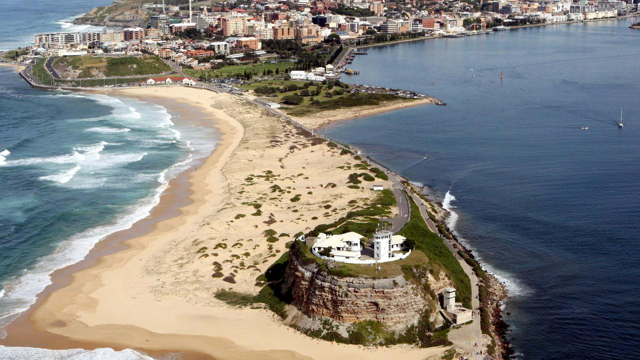 An aerial view of Nobbys headland and beach in Newcastle. There are two suburbs in the city where typical mortgage repayments are cheaper than rent.