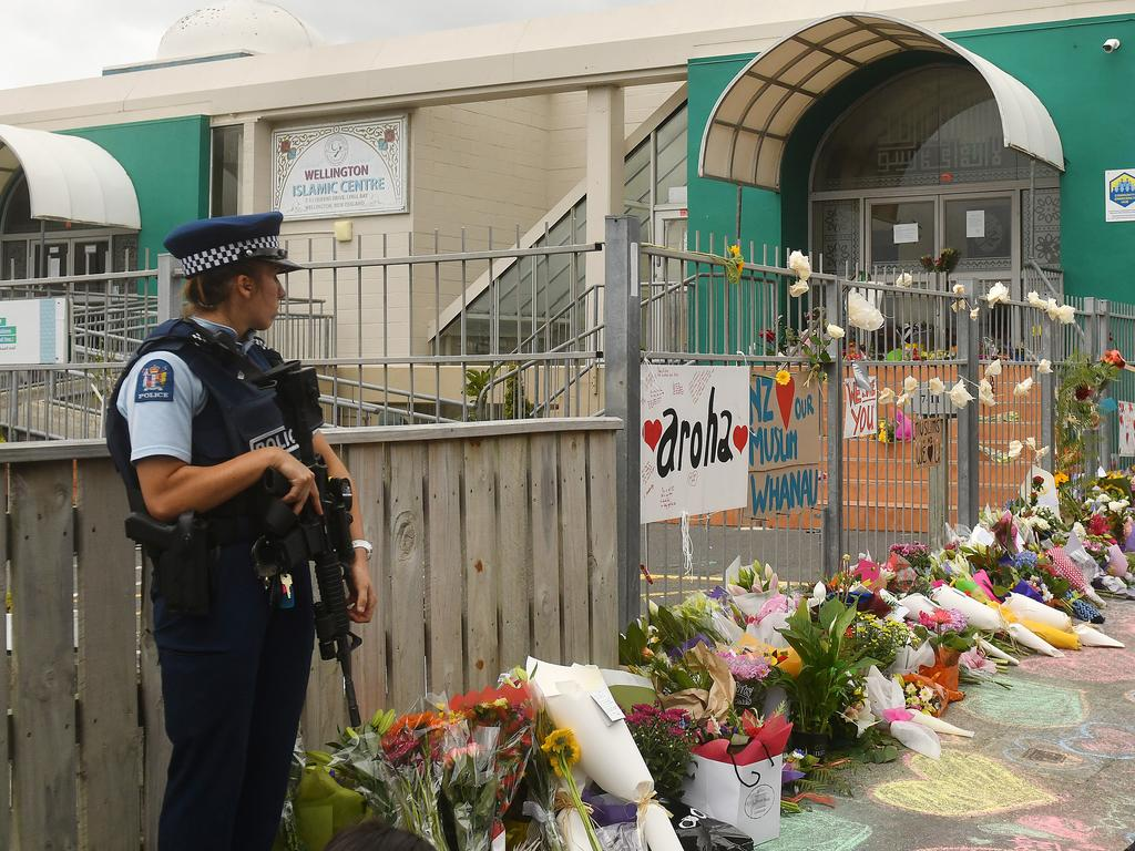 An armed police officer stands guard at the Kilbirnie Mosque in Wellington. Picture: Getty Images