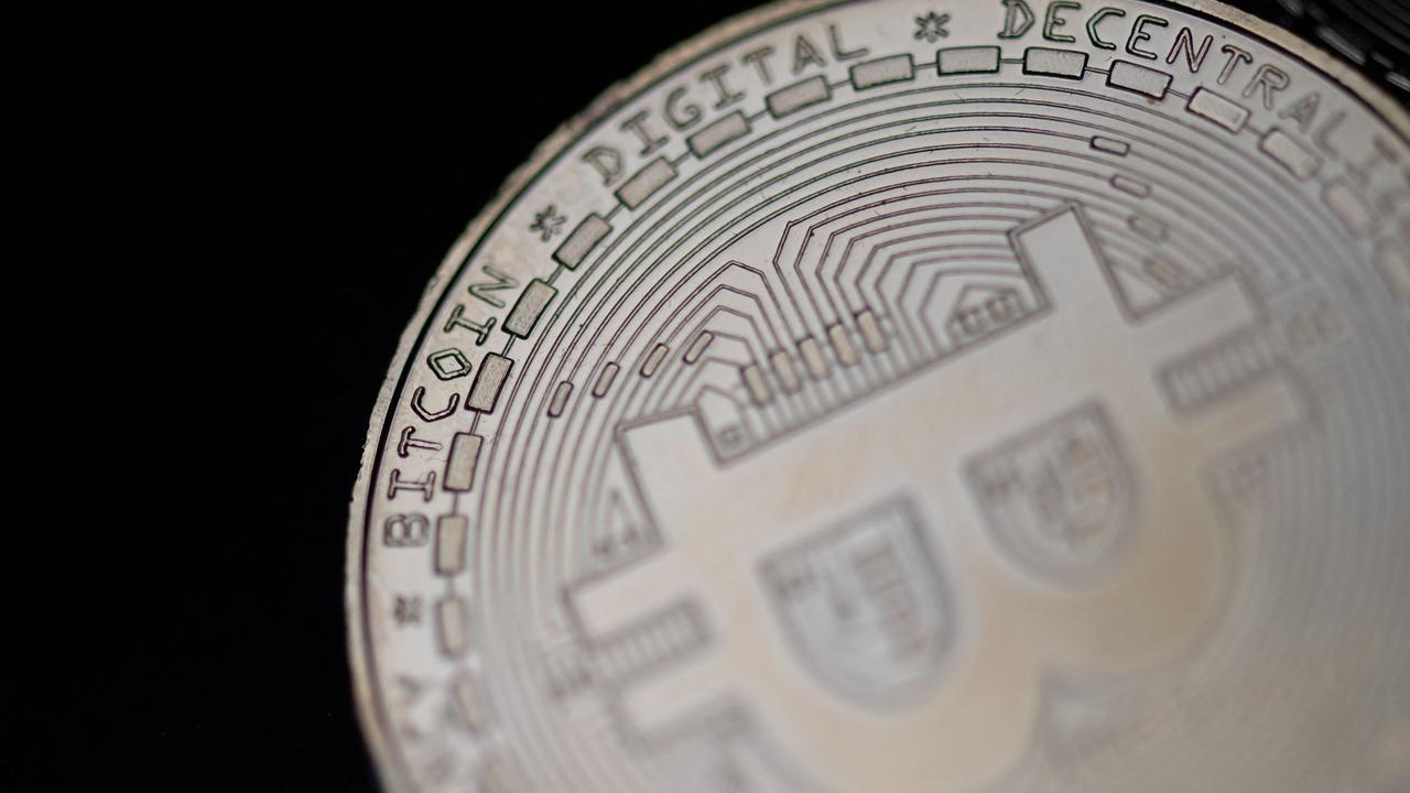 Police have seized nearly £180 million (A$333 million) in the largest-ever cryptocurrency raid in the UK. Picture: Martin Bureau/AFP