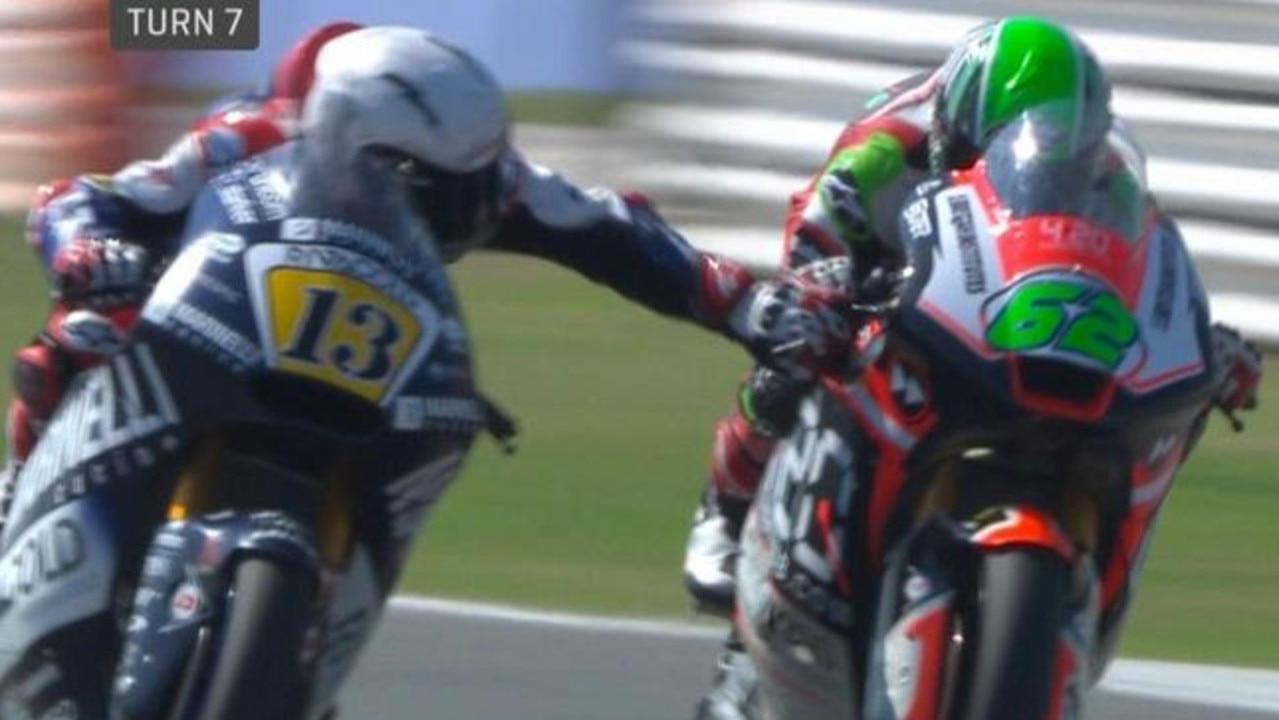 Romano Fenati grabs the brake lever of rival Stefano Manzi mid-race.