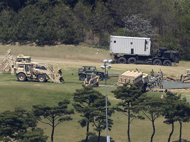 US Army soldiers install their missile defense system called Terminal High-Altitude Area Defense, or THAAD, at a golf course in Seongju, South Korea. Picture: AP