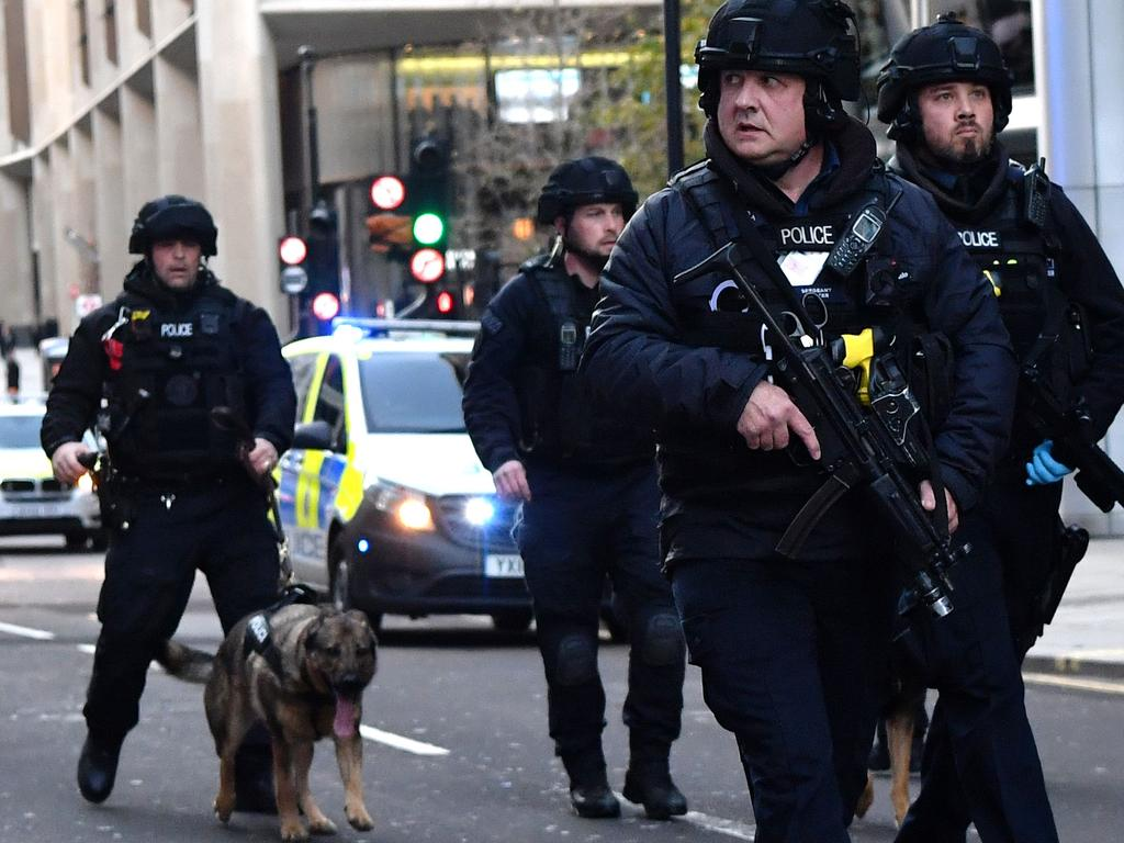 Armed police with dogs patrol checked the area for explosives. Picture: Ben STANSALL / AFP