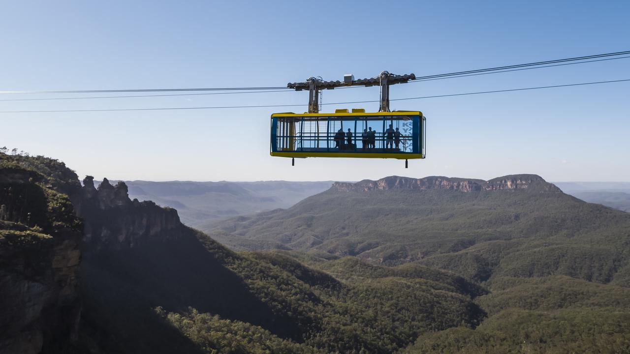 Scenic World, Katoomba Mandatory credit: Destination NSW Description: The Scenic Skyway cabin passes over the Jamison Valley, Katoomba in the Blue Mountains.