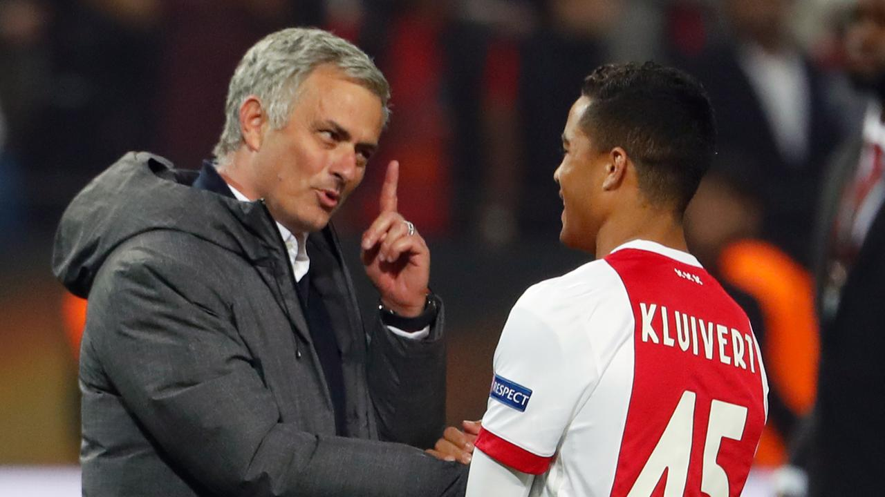 Manchester United's Portuguese manager Jose Mourinho (L) speaks with Ajax Dutch forward Justin Kluivert