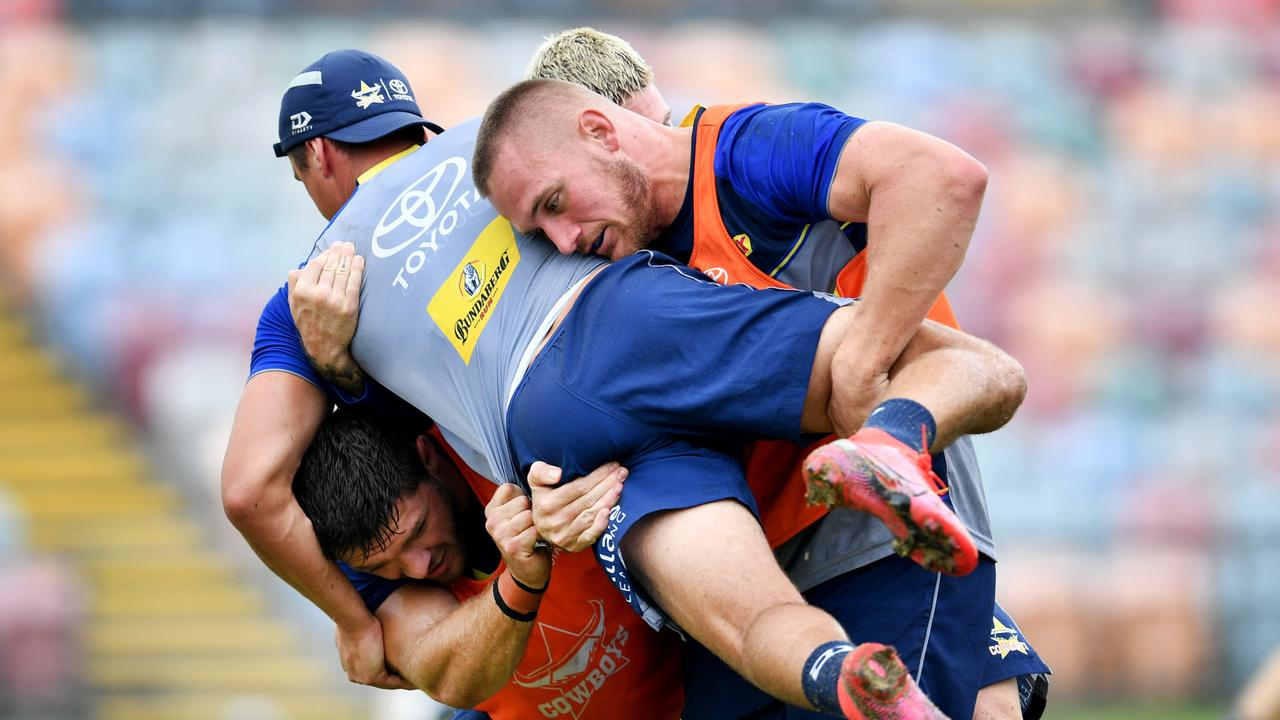 Scott Drinkwater is tackled at Cowboys training.