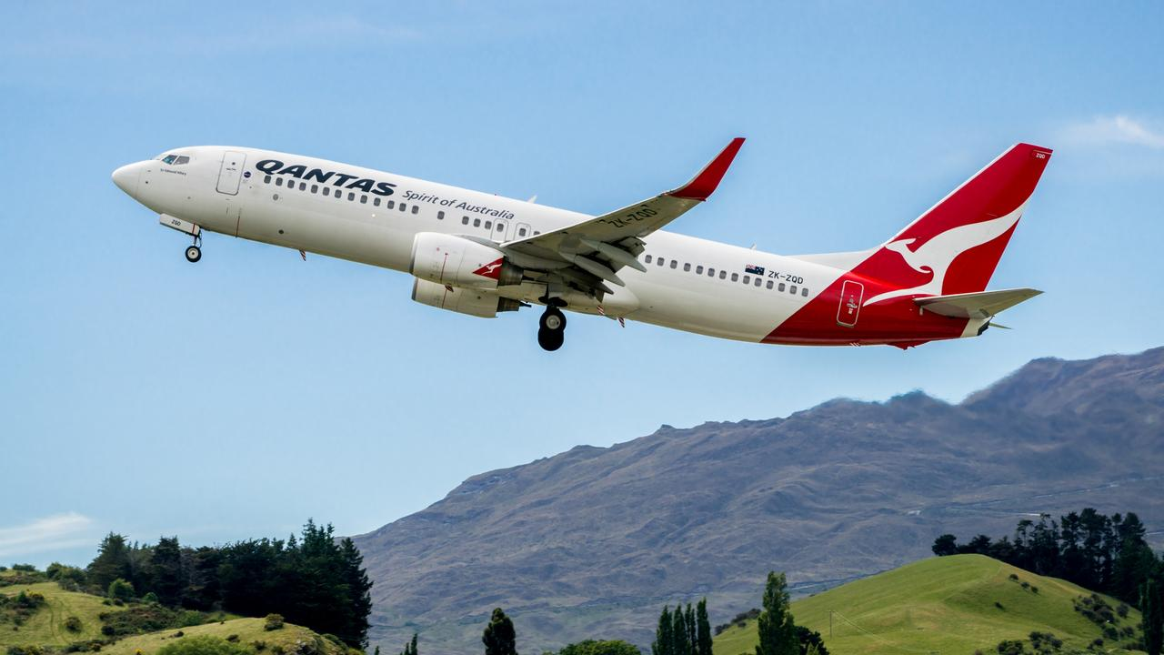 Airplane of Qantas Airways takes off from airport