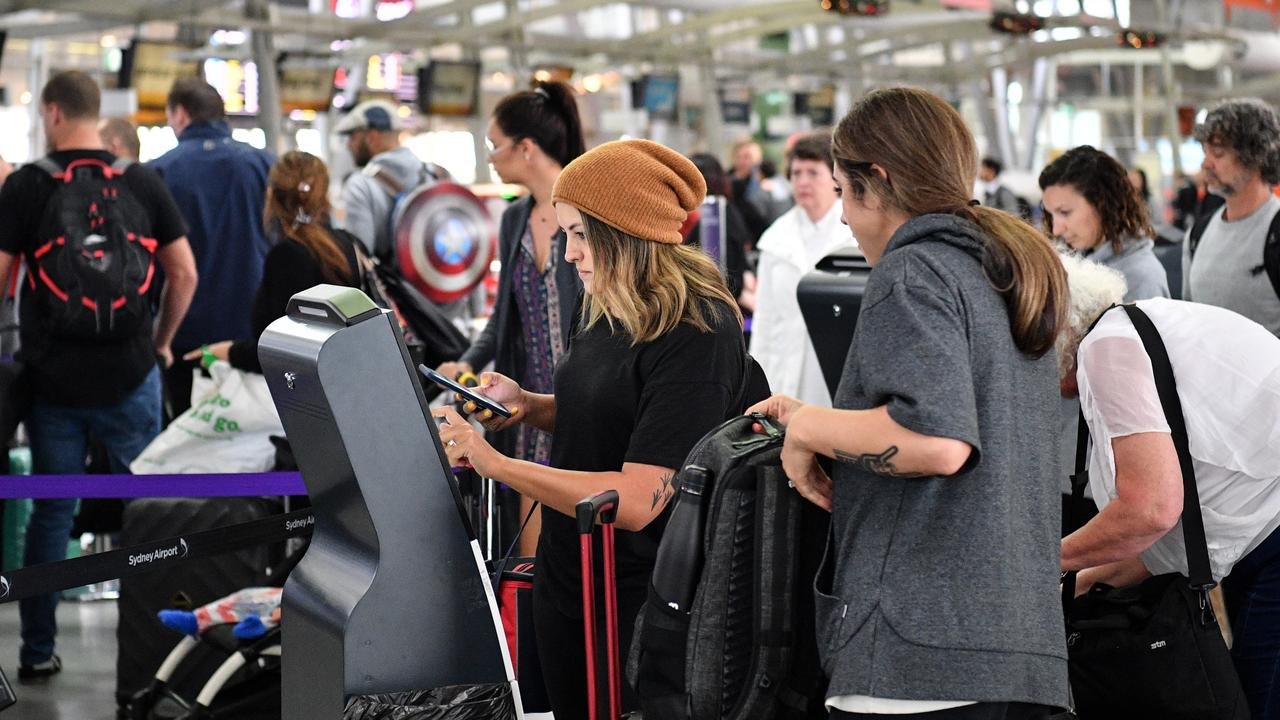 Passengers check in for flights despite long delays on Wednesday. Picture: AAP/Brendan Esposito