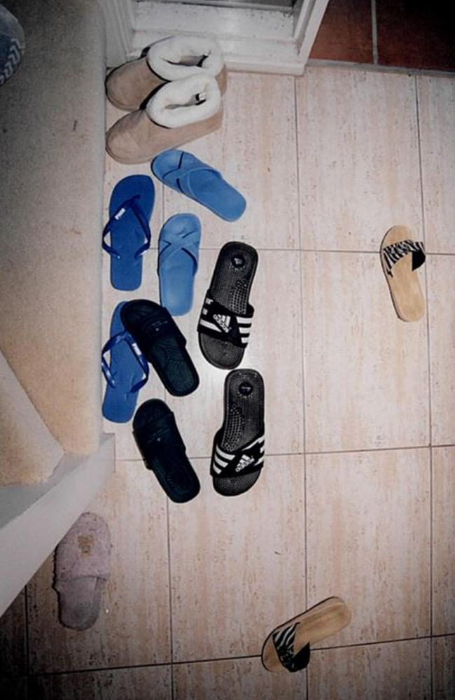 Shoes scattered at the door to the Lin house. - Picture: Supreme Court of NSW