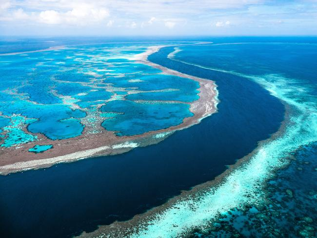 CHANNEL BETWEEN HARDY AND HOOK REEF The deep channel between Hardy Reef and Hook Reef is one of the most spectacular natural formations on planet earth. Here you can witness the dramatic and spectacular drop off the side of each reef plunging into the blue depths below, either by boat or from the air. Picture: Tourism and Events Queensland/Reuben Nutt