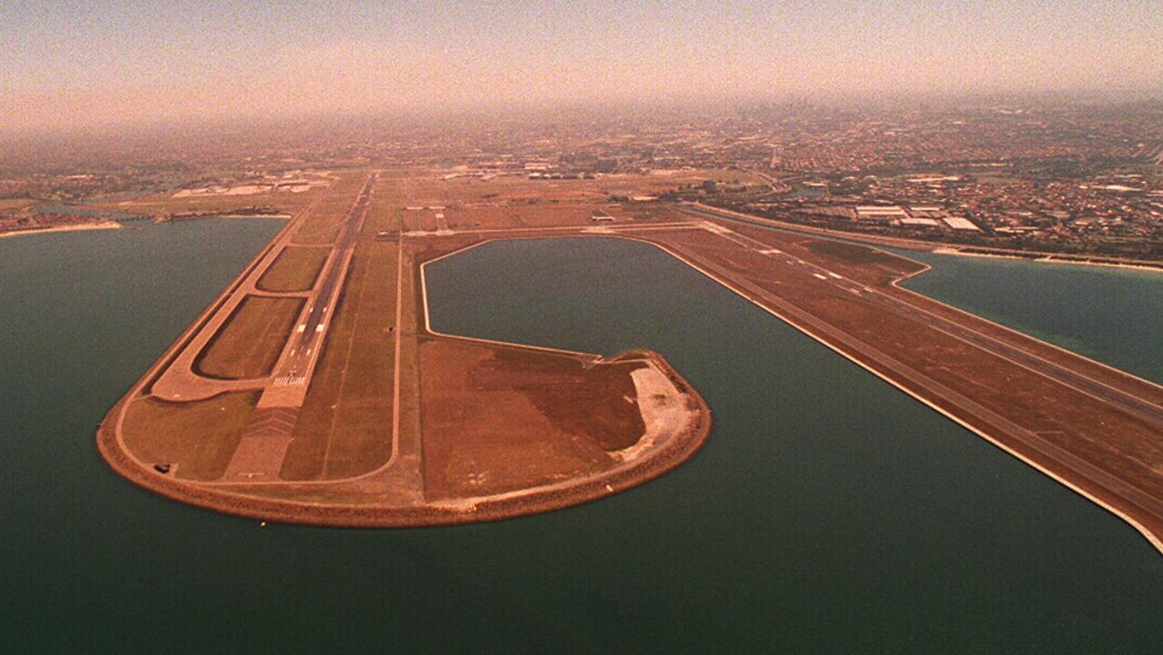 Aerial view of approach to main North-South runway at Kingsford Smith Airport, Mascot, Sydney, with new third runway on right.        NSW / Aviation / Airports / Runways / Exterior