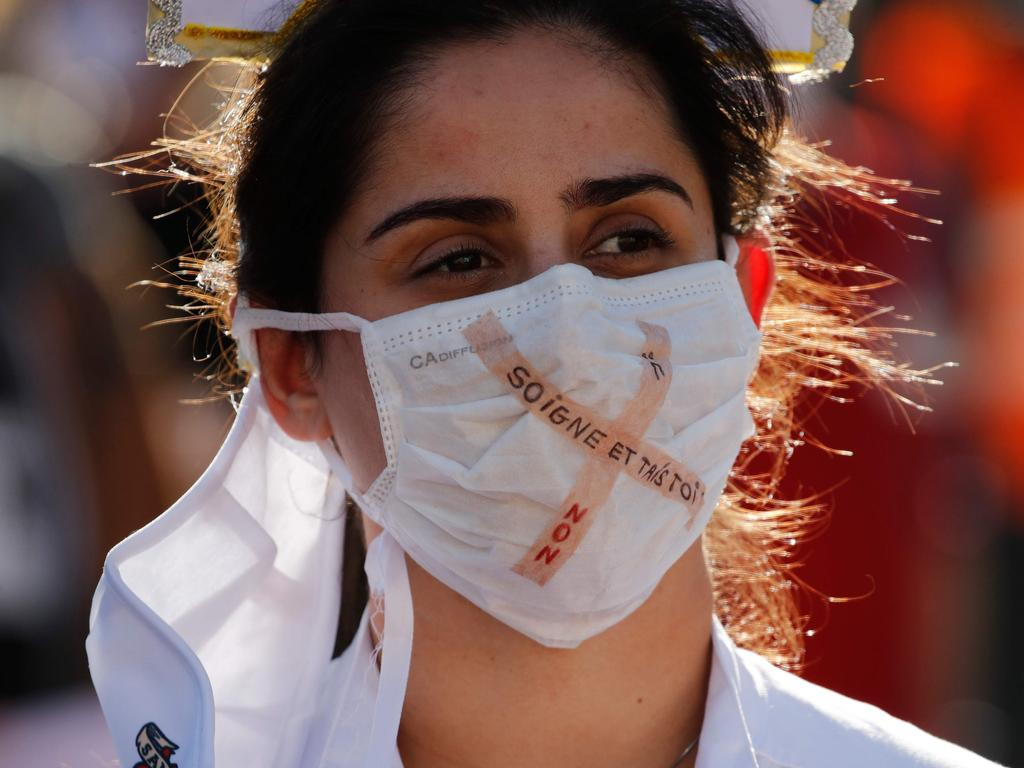 A healthcare worker wears a protective face mask in Switzerland on October 31. Picture: Stefan Wermuth/AFP