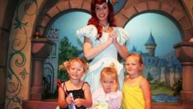 ... And the kid in the middle who perfectly expressed her feelings on her day out at Disneyland. Picture: Reddit