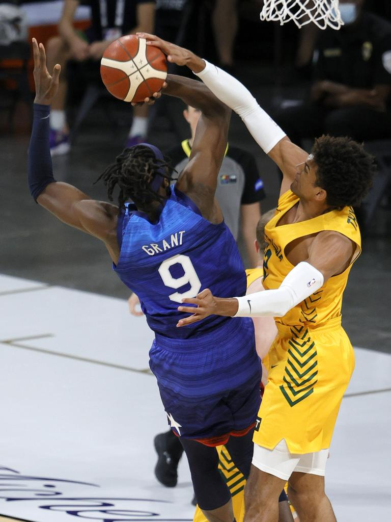 Matisse Thybulle blocks a shot by Jerami Grant. AFP.