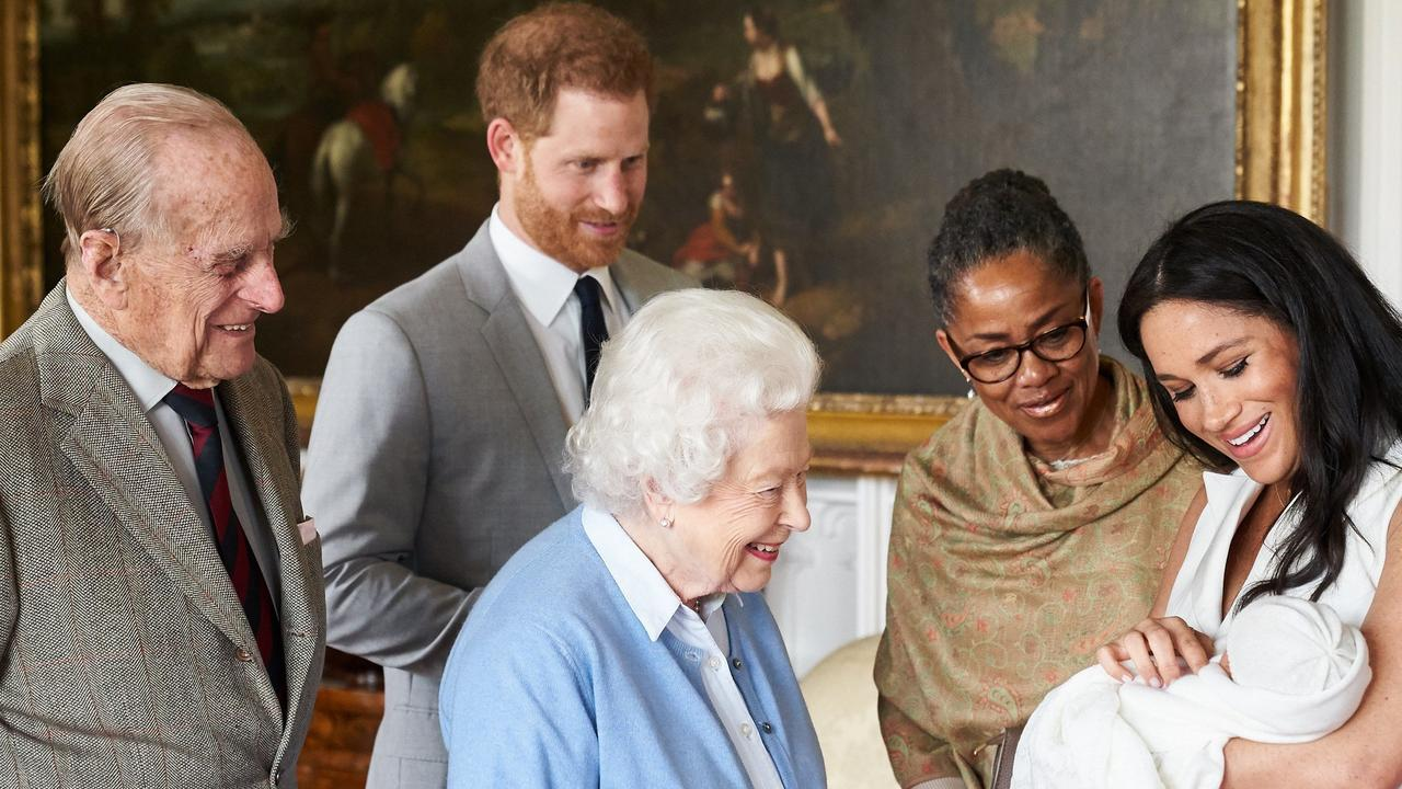 Meghan and Harry showing off a newborn baby Archie to the Queen and Prince Philip, accompanied by Meghan's mother Doria Ragland in 2019. Picture: AFP.