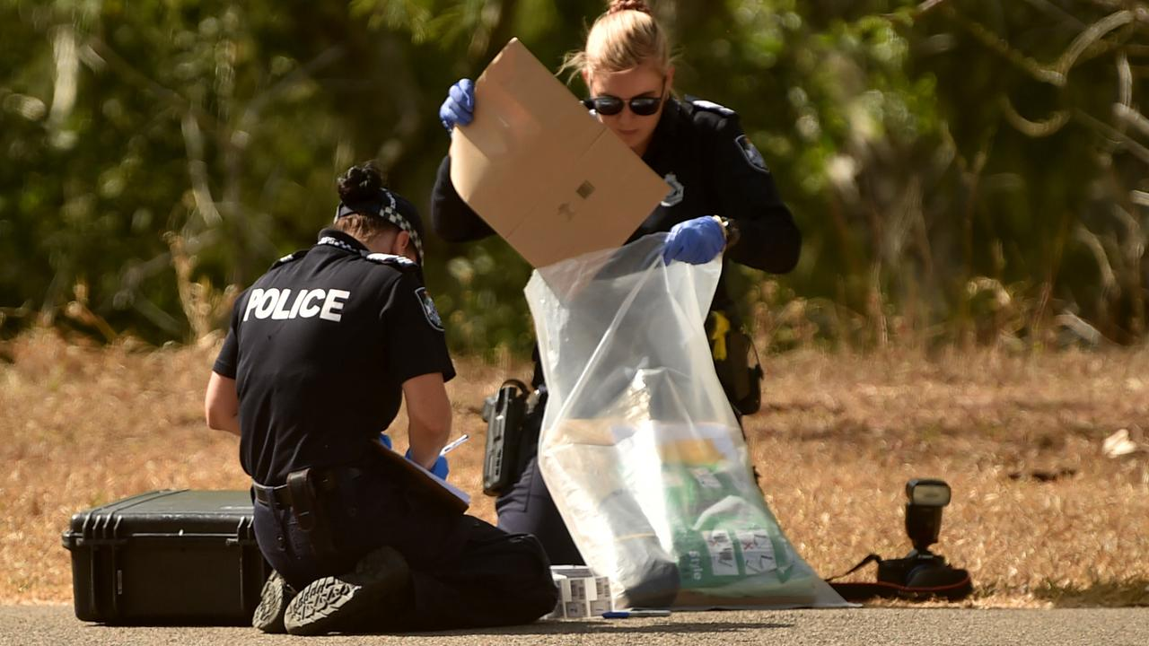Officers gather evidence following a sexual assault on a woman in a Townsville park. Picture: Evan Morgan