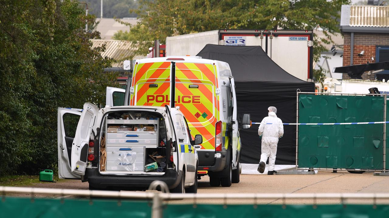 A Police forensic investigation team is parked near the site where the bodies were discovered. Picture: Leon Neal/Getty Images