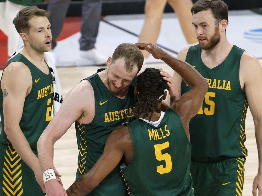 Joe Ingles and Patty Mills hug after Mills hit a three-pointer against Argentina in a warm-up game in Las Vegas earlier this month. Picture: AFP
