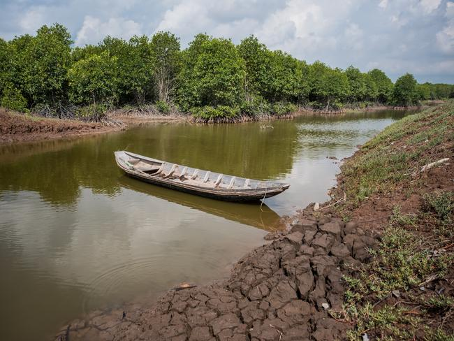 A briny water canal on April 29, 2017 in Bao Thuan Village, Vietnam. The Mekong River Delta is among the most vulnerable regions in South Vietnam, which is home to more than 17 million people and produces around half of the country's rice harvest with its fertile fields. However, climate change is causing the rise of salt content of water in land that has ben used for rice paddies, coconut groves and other crops, threatening the livelihoods of millions of farmers and fishermen. Picture: Linh Pham