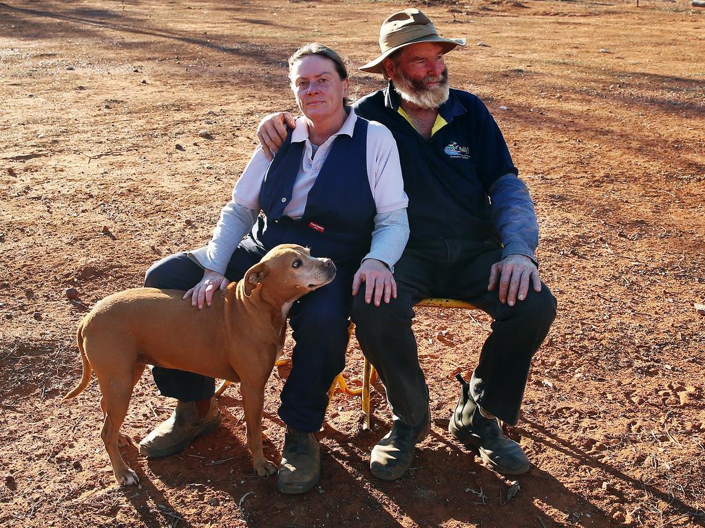 James Foster with partner Rachel Tibbey on Mr Foster's merino sheep station 100km west of Walgett. Picture: Sam Ruttyn