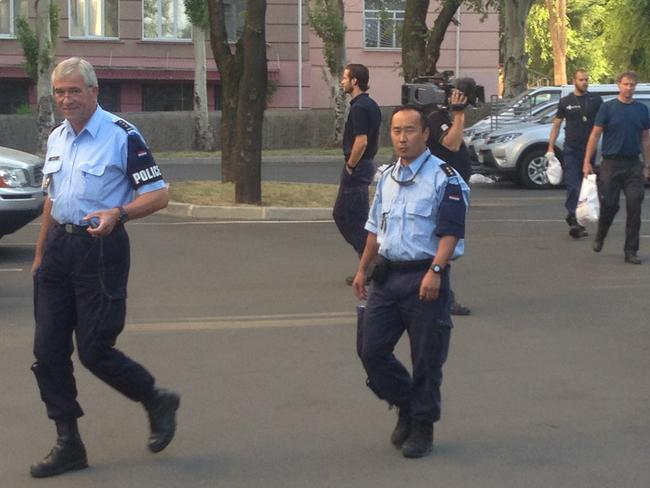Bringing them home ... Dutch and Malaysian police preparing to leave Donetsk this morning to go to the MH17 crash site. Picture: Paul Toohey