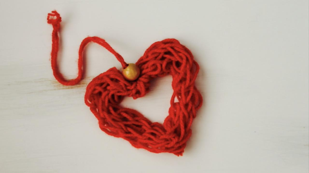 Finger knitting is a great way to improve your child's fine motor skills. And while you're at it, you can make these cute little heart ornaments for Christmas, Valentine's Day or Mother's Day.