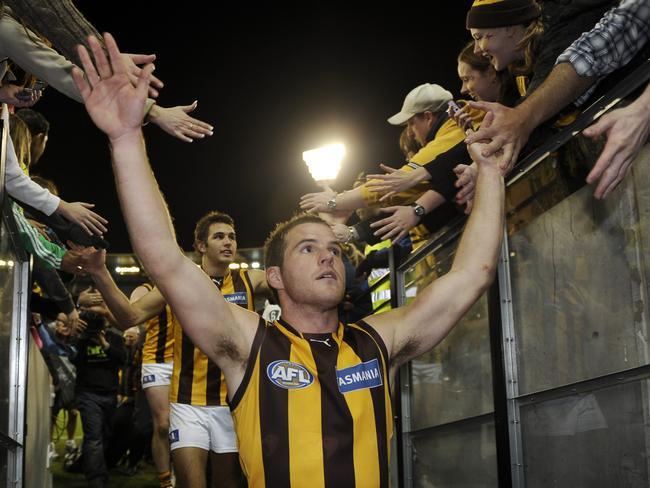 McGlynn slaps fans' hands after a Hawks win over Collingwood.