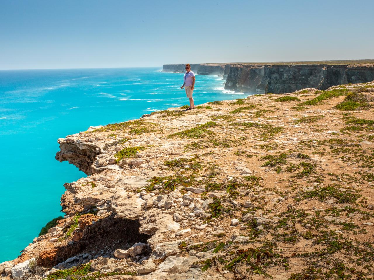Senior lady on the edge of the cliffs at the Great Australian Bight. Nullarbor, SA, Australia