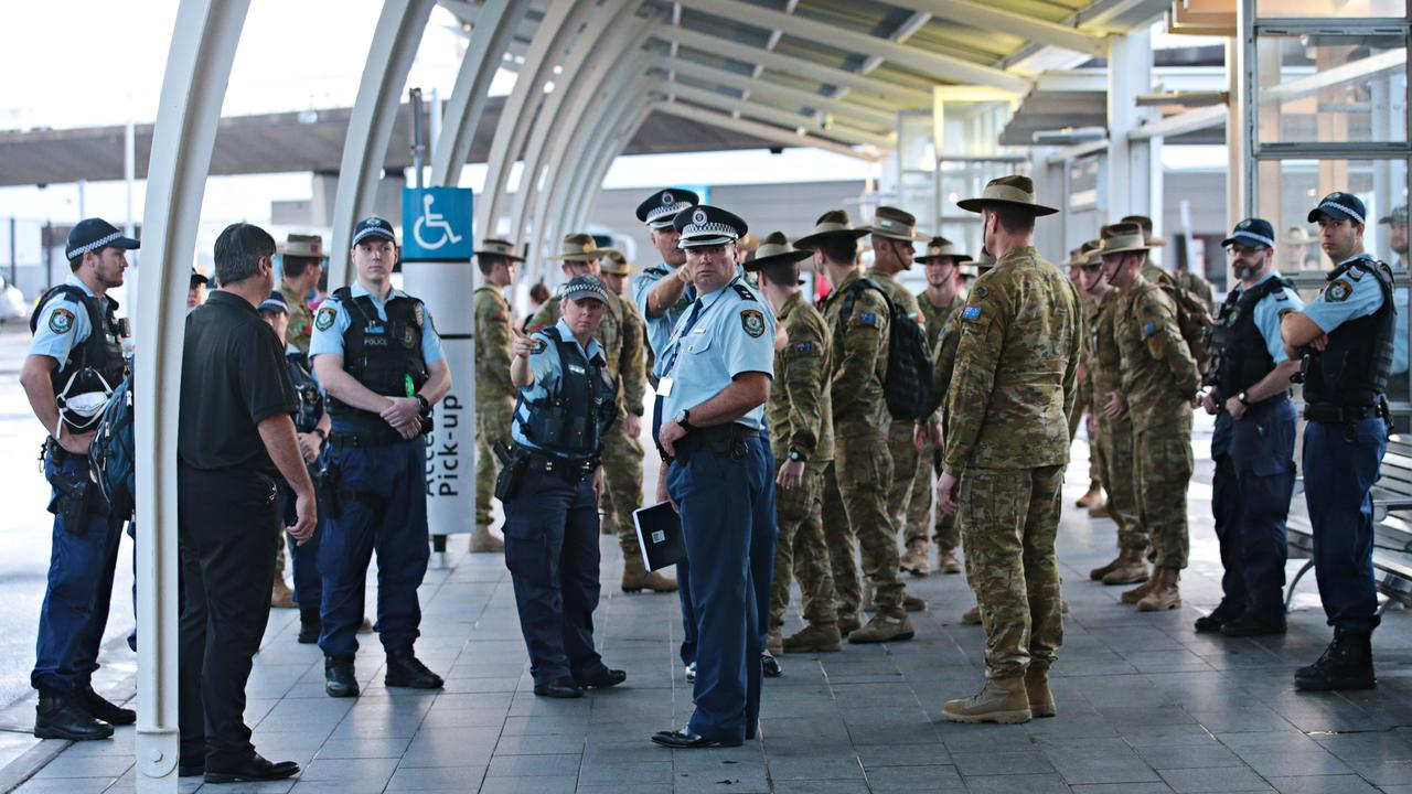 There was a heavy police and army presence for the first lot of international arrivals landing at Sydney Airport on Sunday.