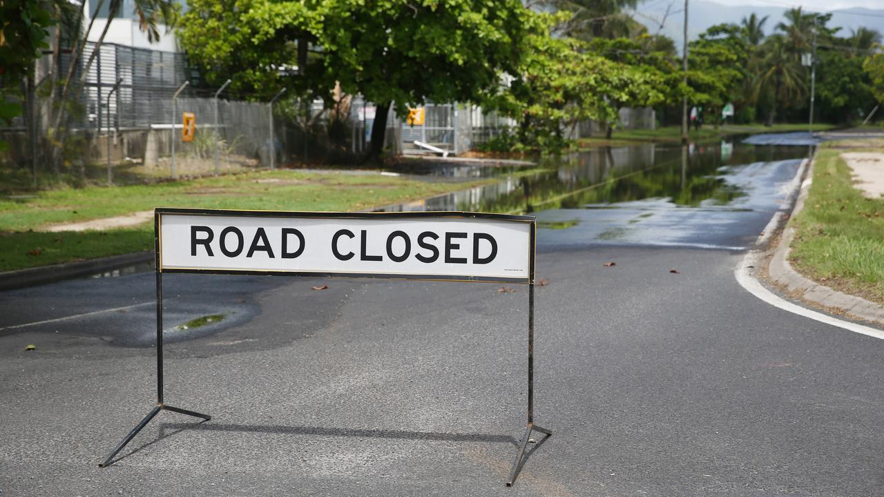 A section of Aumuller Street in the Cairns suburb of Portsmith closed to traffic due to partial flooding of the road from a king tide. Picture: Brendan Radke