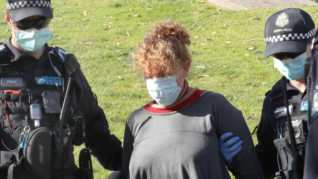 Police arrest a woman after who refused to wear a mask at the Shrine of Remembrance on Friday. Picture: NCA NewsWire/David Crosling