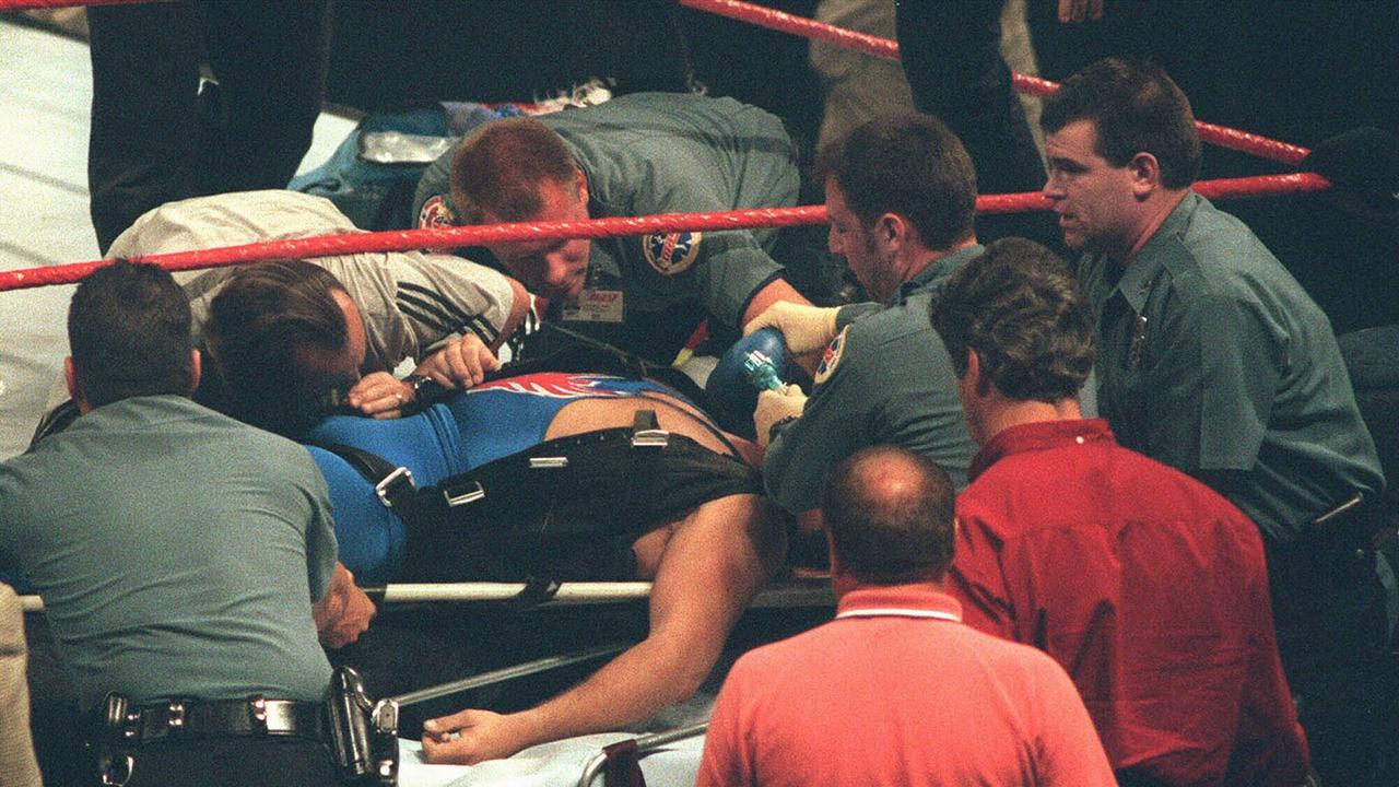 Paramedics work on Owen Hart after his tragic fall. (AP Photo/The Kansas City Star, Todd Feeback)