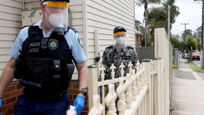 Members of the Australian Defence Force team up with NSW Police to perform compliance checks on residents in lockdown in western Sydney. Picture: News Corp Australia