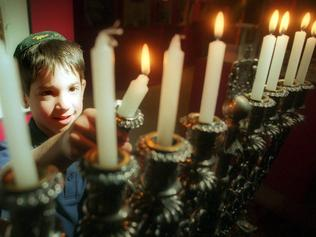 25/11/2002. Adam Schwarz gets ready for Hanukkah at the Jewish Museum.