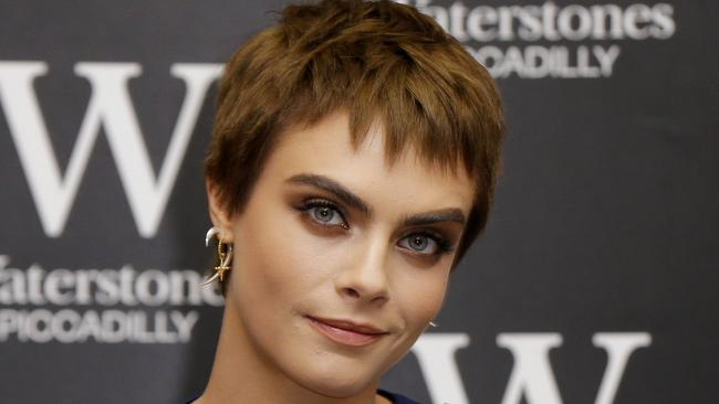 Model and actor Cara Delevigne alleges Weinstein asked her for a threesome. (Pic: Alastair Grant/AP)
