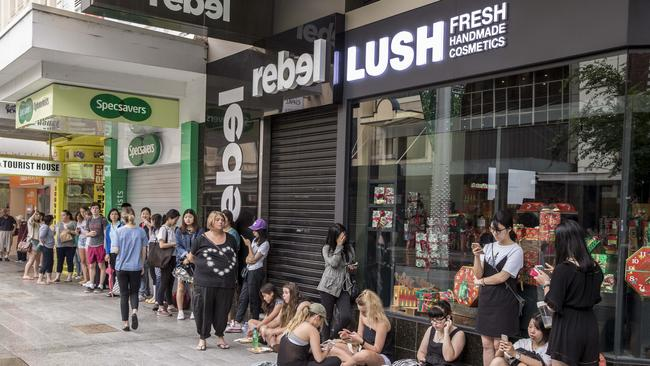 Bargain-hunters waiting for shops to open in Rundle Mall. Photo: Mike Burton.