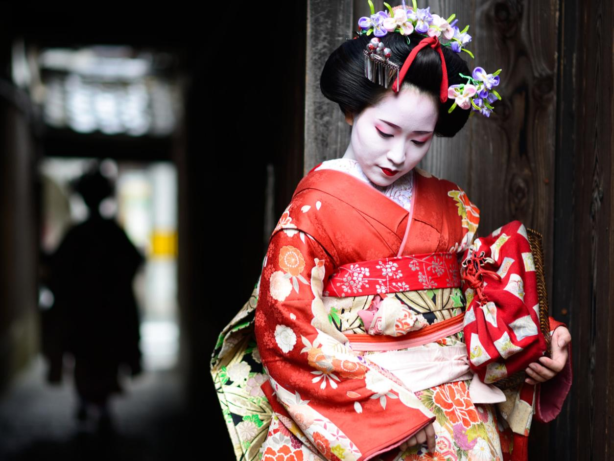 Two young maiko girls, geishas in training, in the streets of Kyoto.