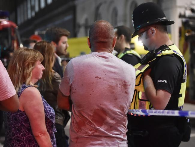 Jag Sandue speaks with police officers after an incident near London Bridge. Picture: Reuters