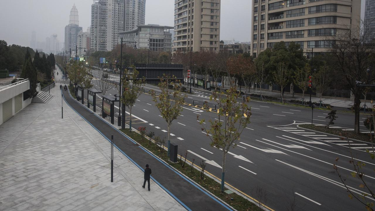 A man walks alone on an empty road in Wuhan. Picture: Getty Images