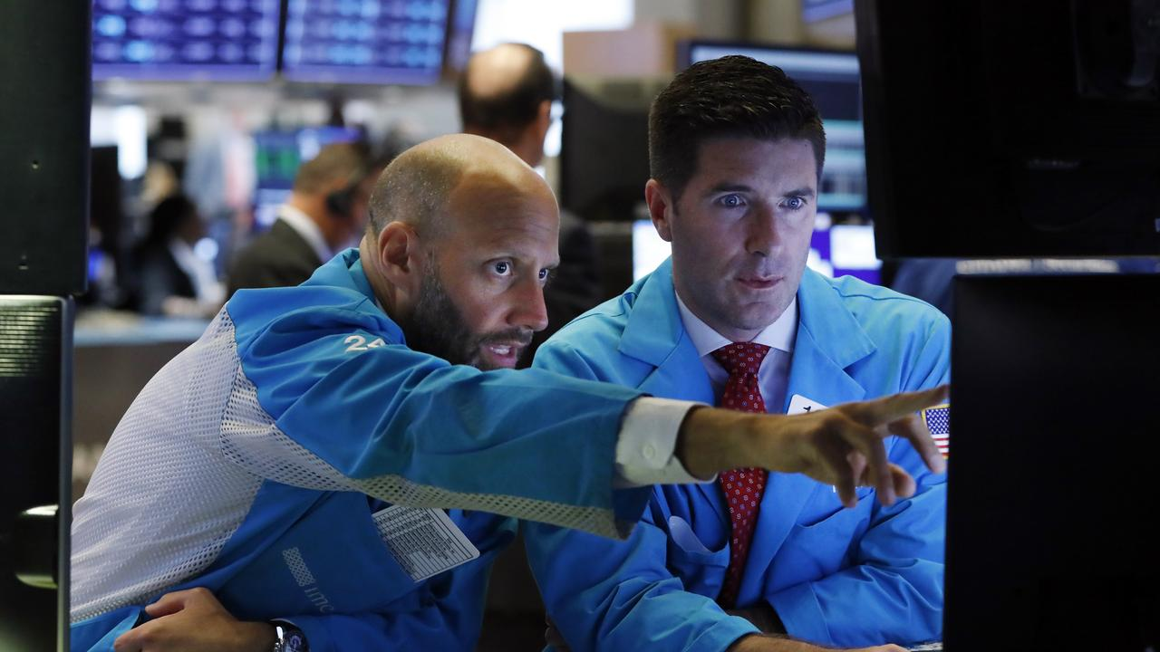Stock markets turned higher as China stabilised its currency. Picture: Richard Drew/AP