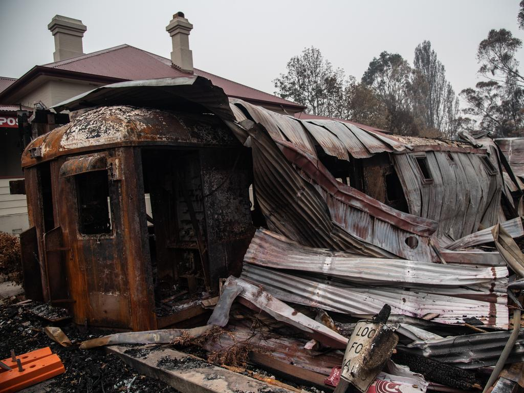 The remains of a burnt-out train carriage that used to be a cafe in Cobargo. Picture: AAP Image/James Gourley