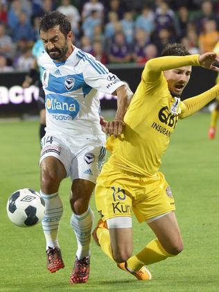 Khalfallah takes on Jamie MacLaren of Perth Glory.