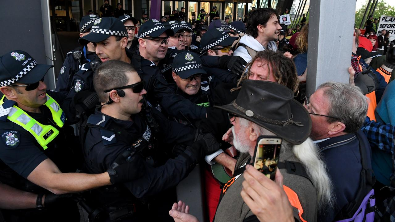 A wall of police meets a wall of protesters. Picture: James Ross/AAP