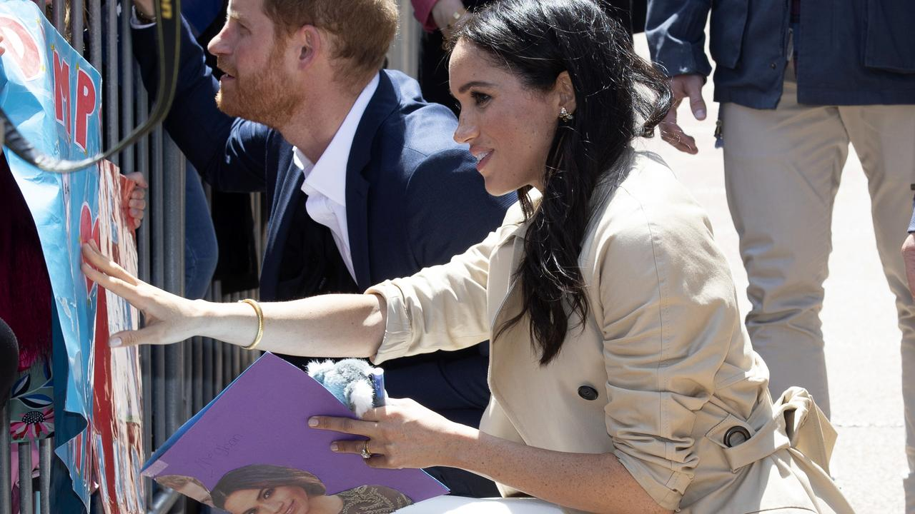 One fan gave the couple a poster and a stuffed koala. Picture: Paul Edwards/Pool via AP