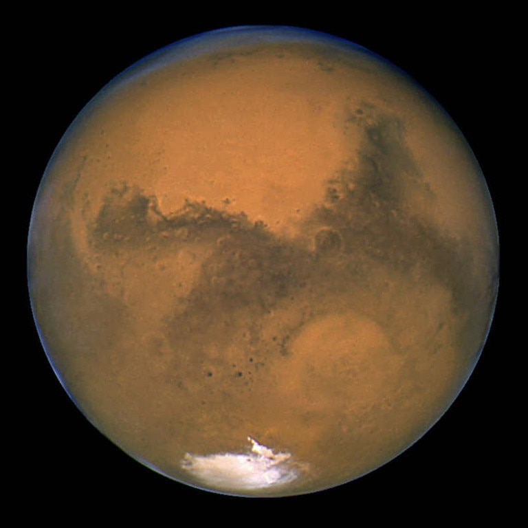 Graphic image of planet Mars taken by Hubble Space Telescope at 7.51pm and released soon after 27/08/2003, is as at point in night sky closest to earth than at anytime in past 60,000 years.