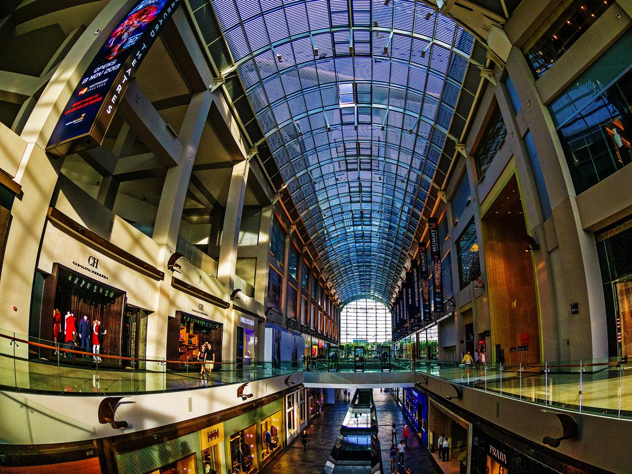 An interior general view of The Shoppes at Marina Bay Sands showing the curved ceiling and rows of shops, Singapore. FAQ, sunday escape
