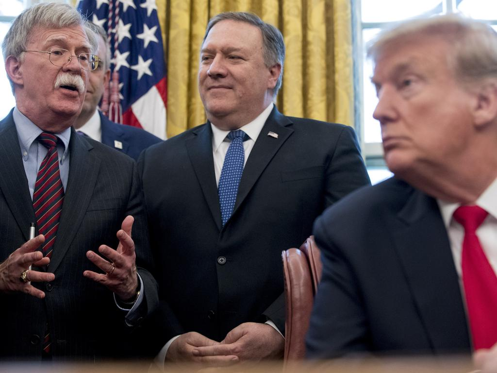 Security adviser John Bolton, Secretary of State Mike Pompeo, and President Donald Trump. Bolton says he resigned but Trump tweeted he was asked for his resignation. Picture: AP