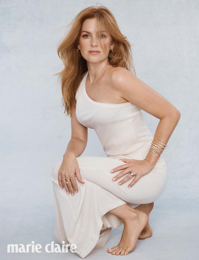 Fisher looked chic in a one-shouldered cream dress. Picture: Marie Claire