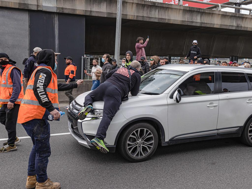 Another protester seen on the bonnet of a car stuck on the West Gate Bridge. Picture: Jason Edwards